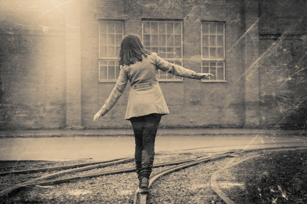 bigstock-Girl-Walking-On-The-Railway-R-71207725.jpg